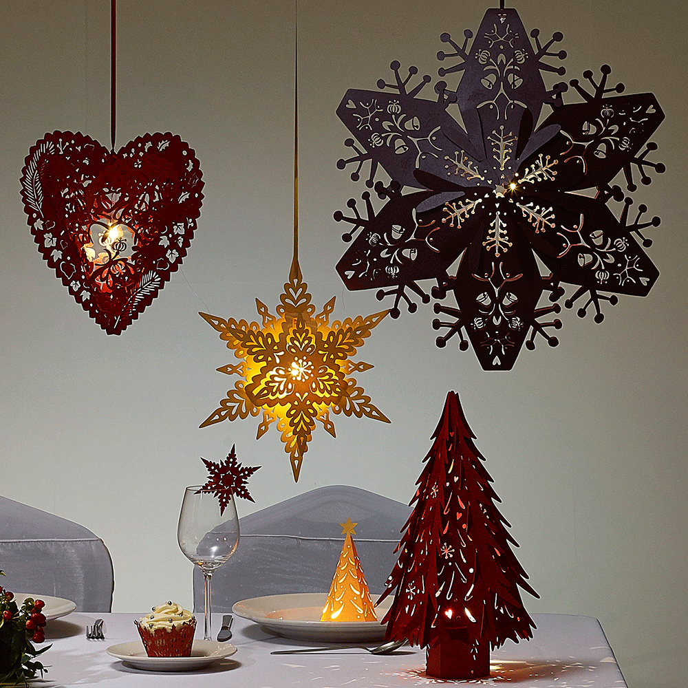 lasercut snowflake Christmas decorations in Stardream Ruby