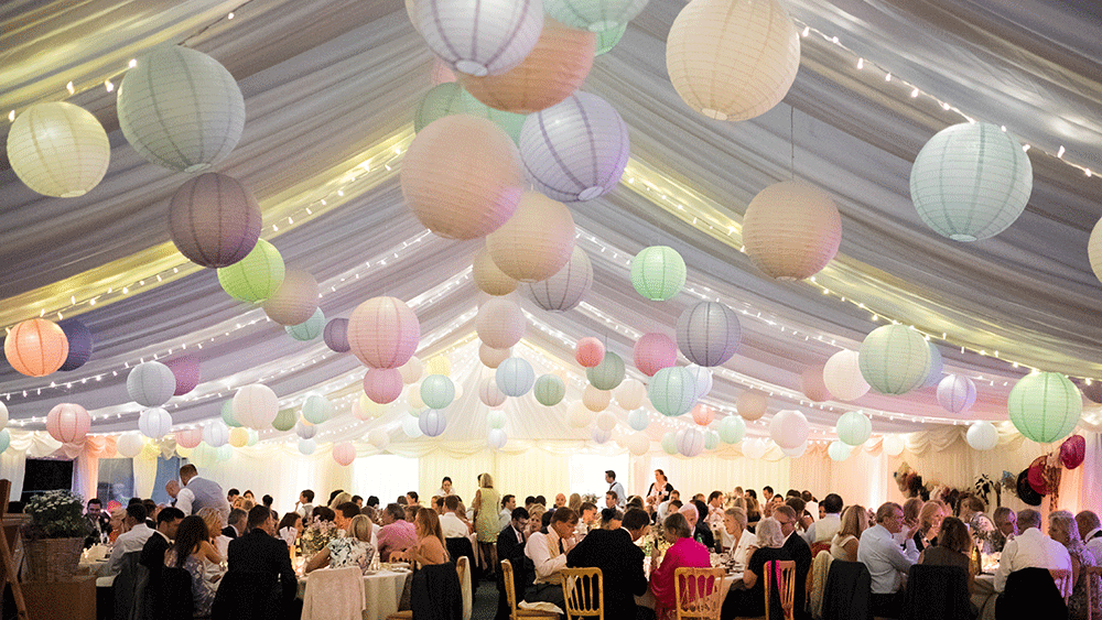 Pastel Paper Lanterns Create A Festival Themed Wedding Hanging Lantern Company