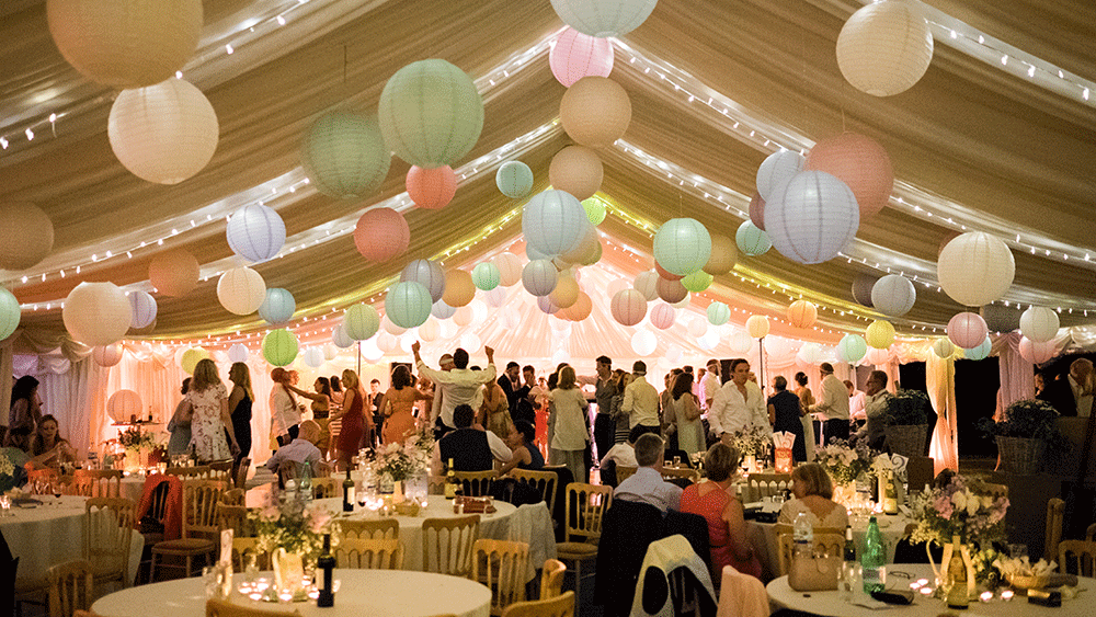 Pastel paper lanterns create a festival themed wedding
