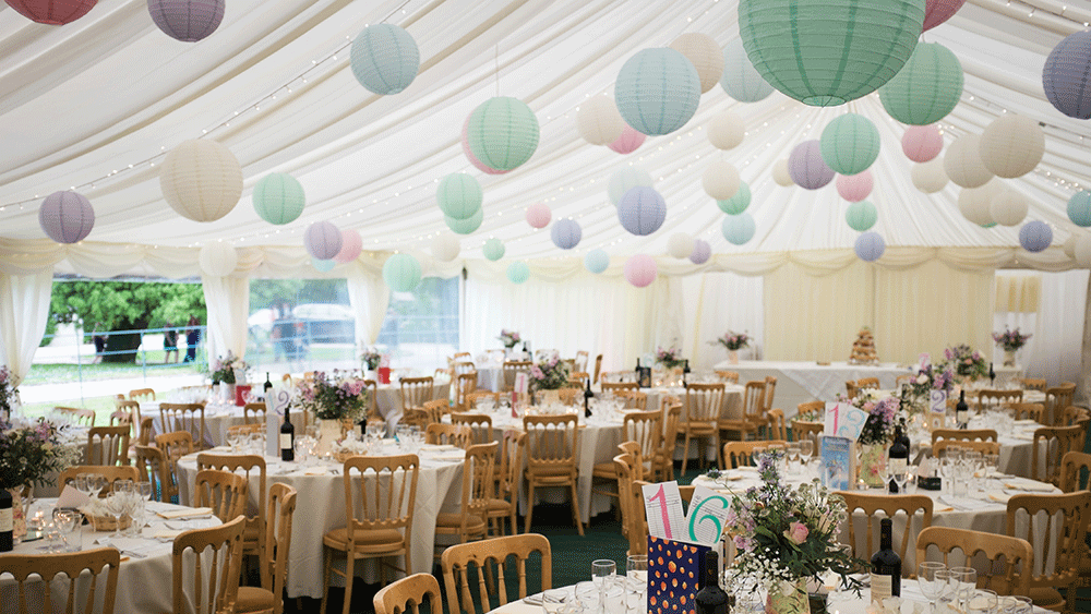 pastel paper lanterns create a festival themed wedding hanging lantern company. Black Bedroom Furniture Sets. Home Design Ideas