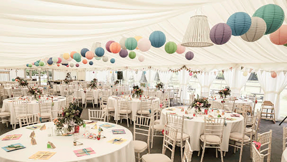 Welsh Wedding Marquee Decorated With Multi Coloured Paper Lanterns