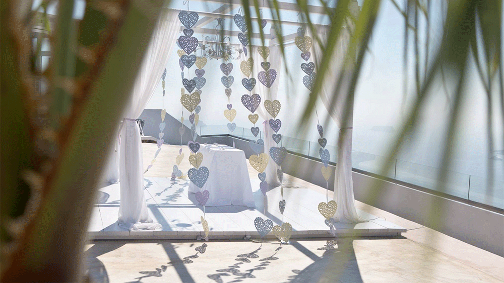 Vertical Heart Bunting Adorns Wedding in Santorini