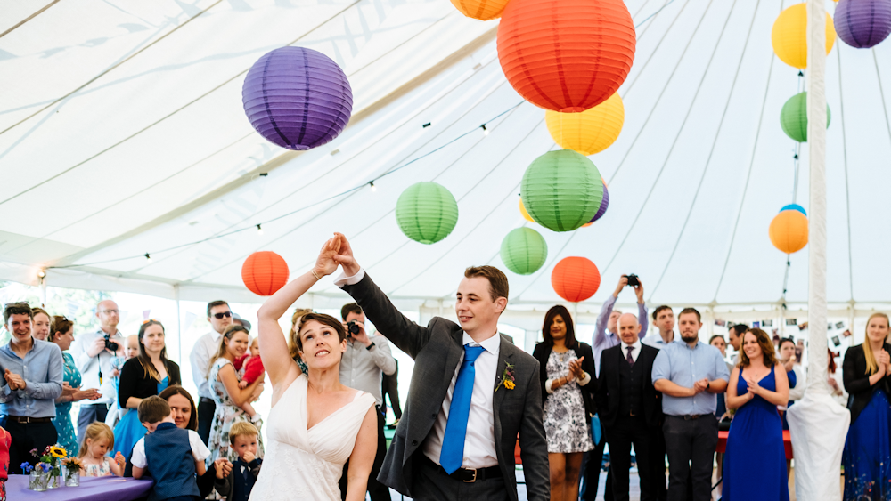Hanging Lanterns decorate Traditional Marquee