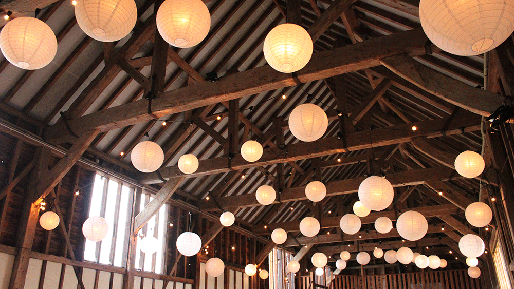 Ivory lanterns provide a rustic, classic look at weddings
