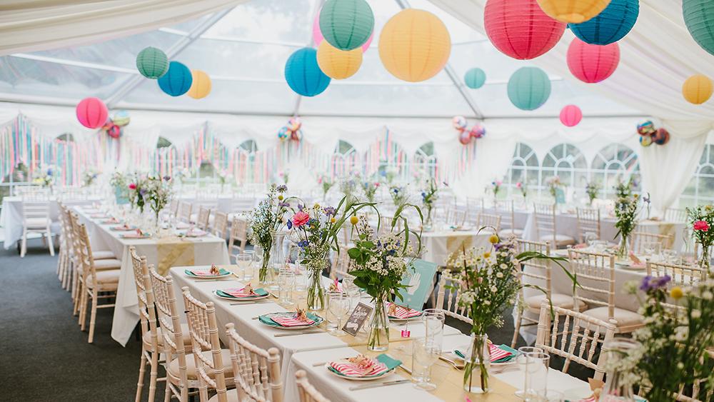 Garden festival themed coloured lanterns dress Sussex Bell End Tent
