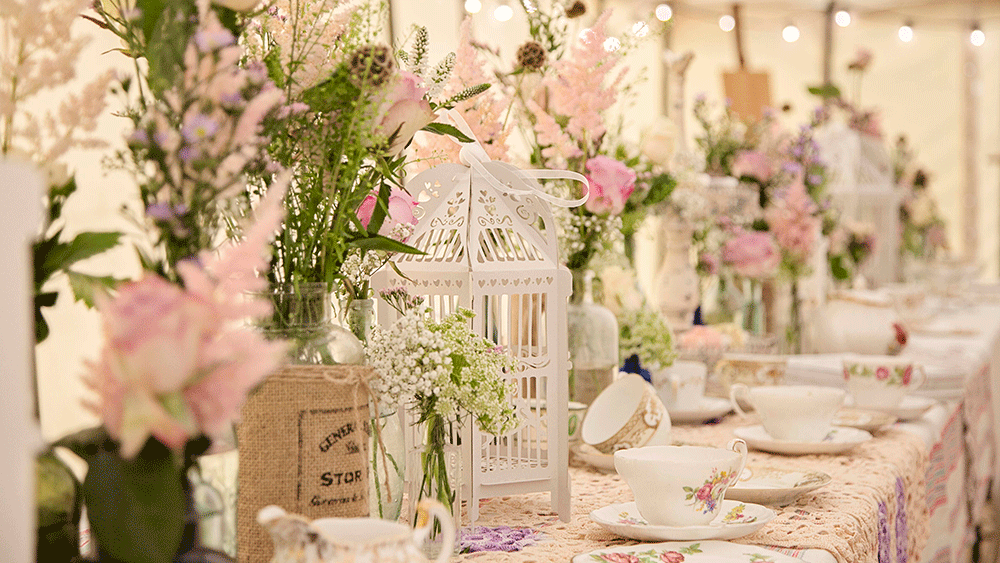 Create An English Country Garden Wedding With Birdcage Lanterns And Vintage Crockery Hanging