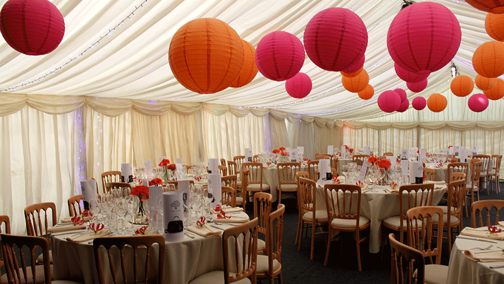 Bring Warmth to your Marquee Wedding with Coloured Paper Lanterns