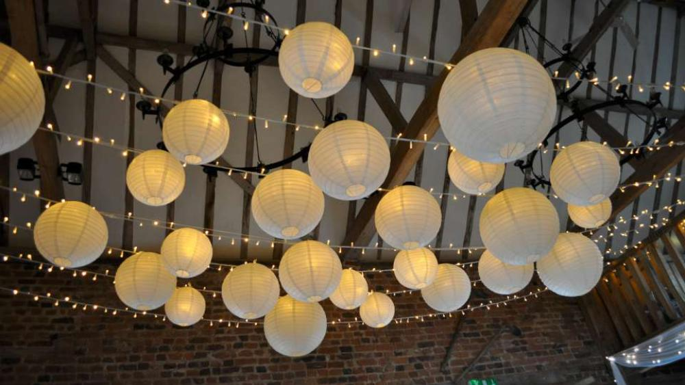 Rustic Lanterns And Twinkling Fairy Lights Hanging