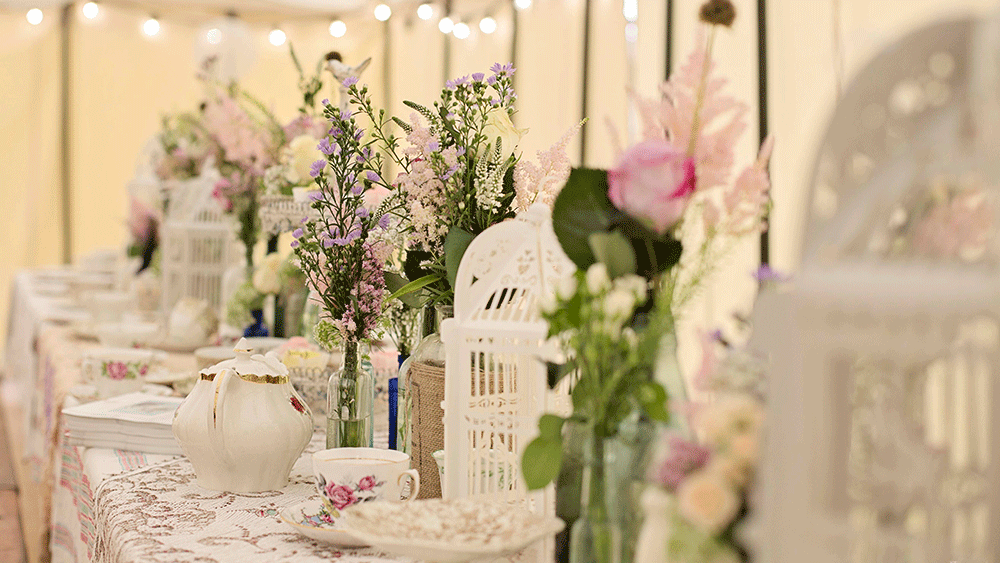 Create an English Country Garden Wedding with birdcage lanterns and vintage crockery