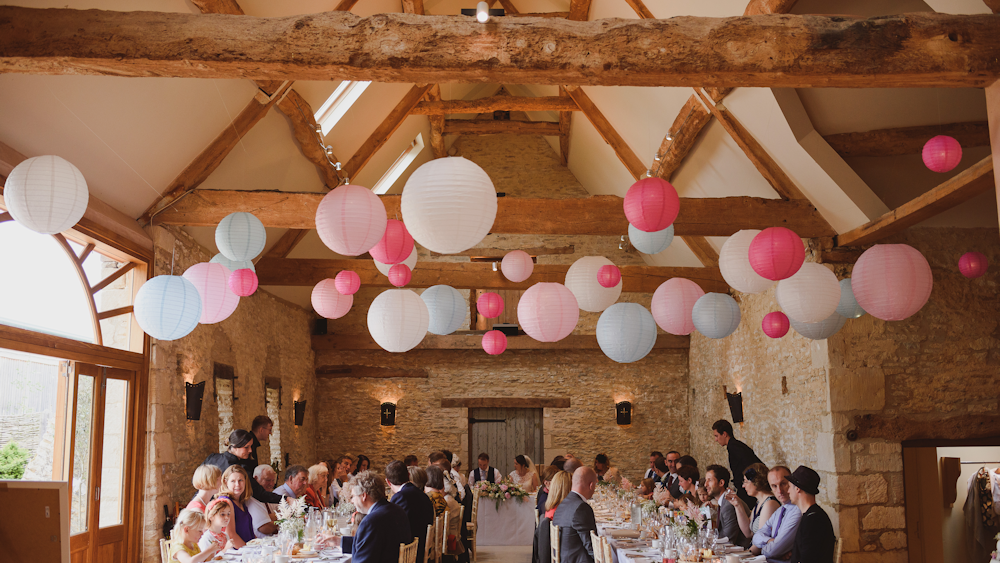 Pink and blue paper lanterns create a fabulous feature in Oxleaze Barn