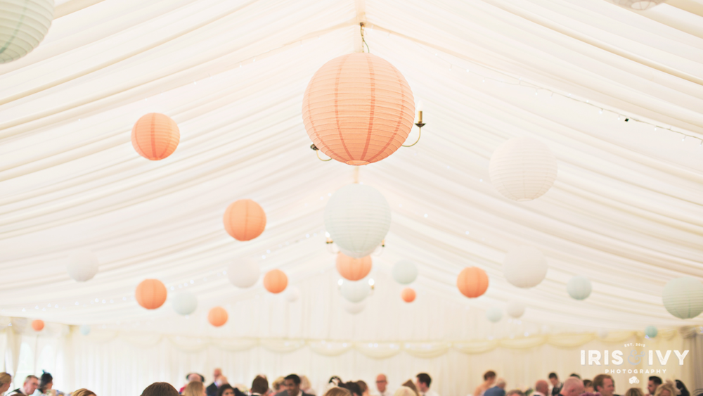 Peach and baby blue hanging lanterns at Wethele Manor