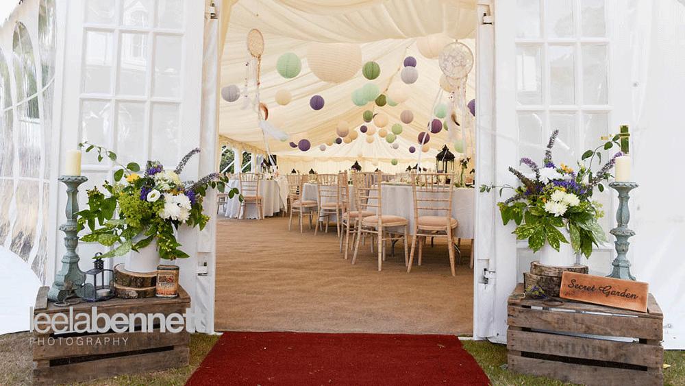 Wedding Lanterns Decorate a Secret Garden Style Marquee