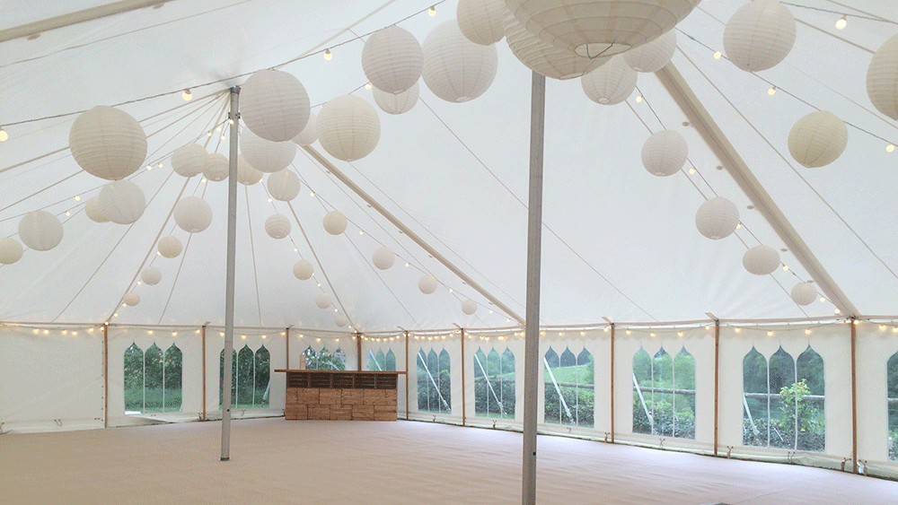 White and Cream Paper Lanterns Dress a Traditional Somerset Marquee