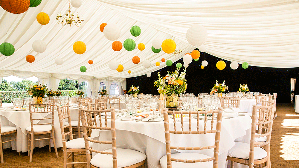 Brighten a white marquee with summery coloured lanterns