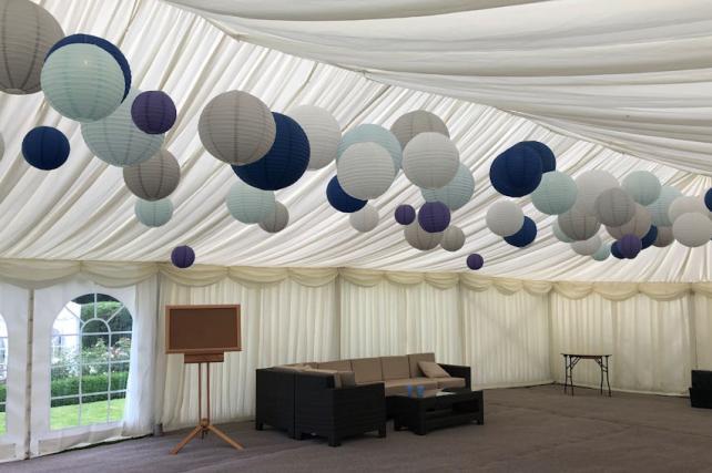 Blue paper lanterns in wedding marquee
