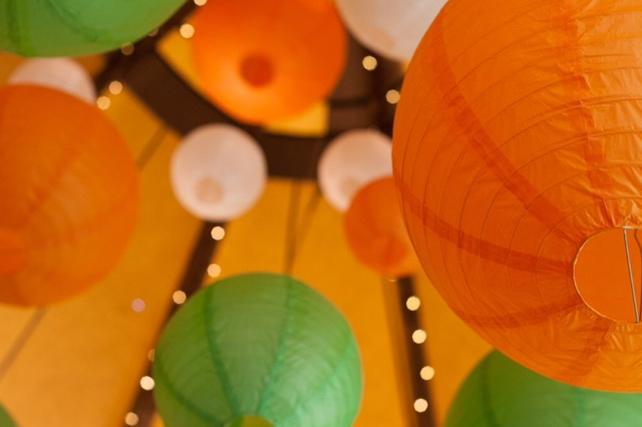 Brightly coloured lanterns decorate tipi