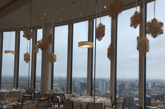 Laser Cut Gold 3D Snowflakes decorate private London restaurant