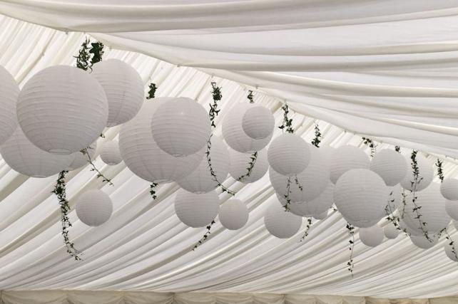 Hanging lanterns and ivy at wedding