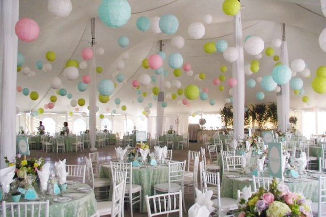 Pastel paper lanterns in wedding marquee