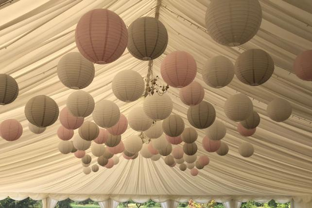 Pink and dove paper lantern canopy at Kingston Bagpuize House