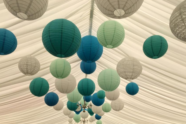 Green and blue hanging lanterns decorate Berwick Wine Centre