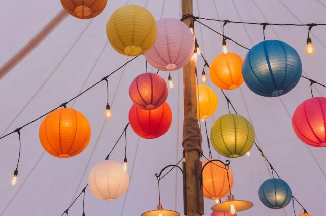 Coloured paper lanterns and festoon lights