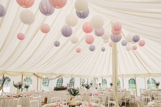 Rustic hanging lanterns in traditonal marquee