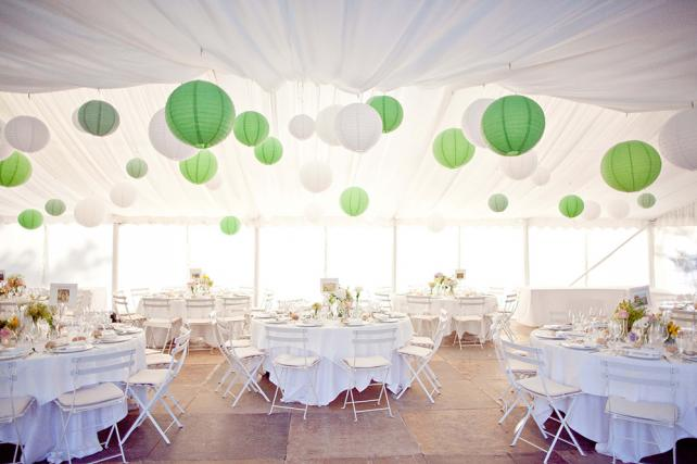 Green and white paper lanterns in a wedding marquee
