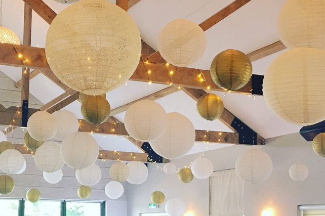 Gold and lace lanterns decorate The Boathouse