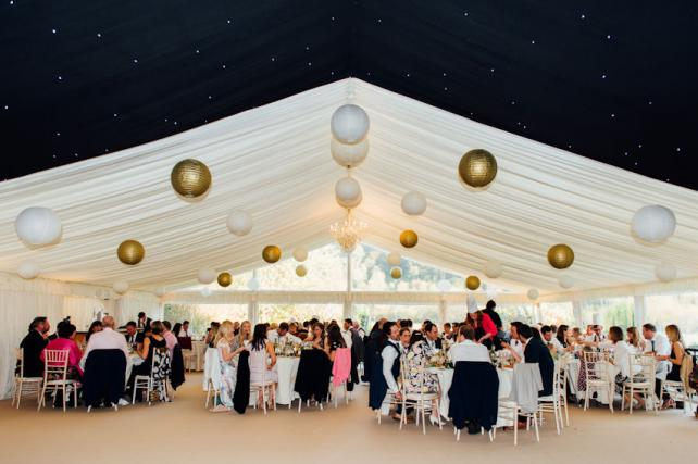 Simple gold and white wedding lantern canopy