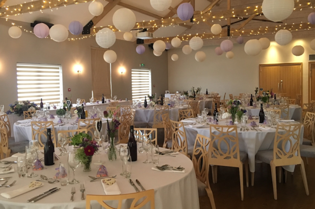 The Boathouse decorated with Lavender and Lilac Hanging Lanterns
