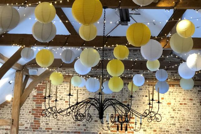 Upwaltham Barns decorated with Yellow Hanging Lanterns
