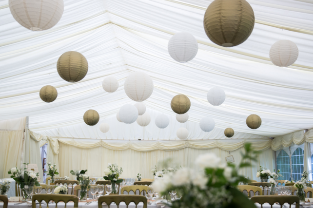 White and gold marquee wedding lanterns