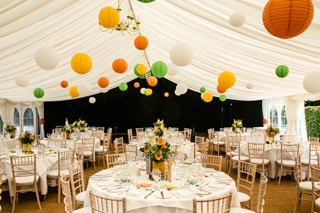 Brighten a white marquee with summery coloured lanterns
